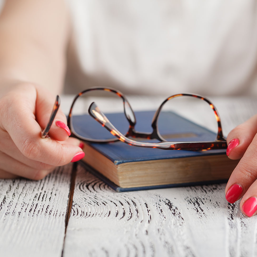 image of eyeglasses on a book