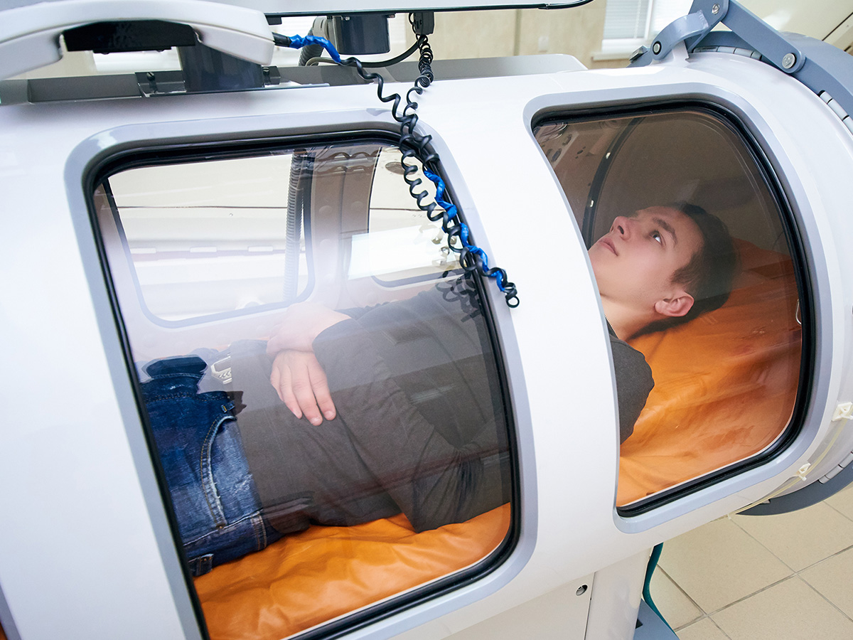 person in a hyperbaric chamber