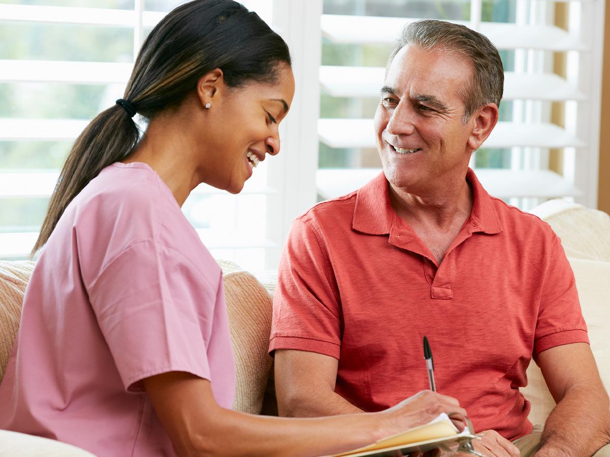 nurse talking with a senior man