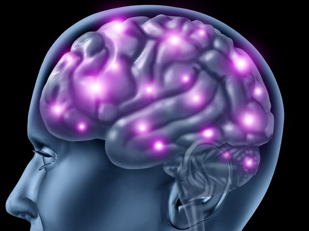 head with neurons firing and glowing showing neurological function